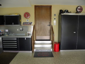global garage flooring remodel with stainless steps