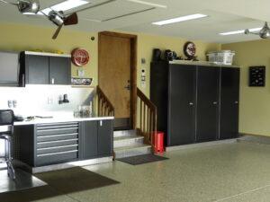 global garage flooring remodel with storage cabinets