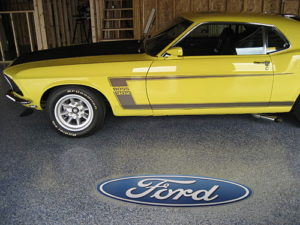 mustang on blue global garage flooring with Ford inlay
